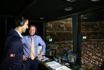 """Novak Djokovic visits the ESPN booth with Chris Evert and Patrick McEnroe during the 2015 BNP Paribas Open in Indian Wells, California on Thursday, March 19, 2015."""