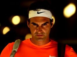 """Roger Federer looks on in the tunnel before a quarter-final match against Tomas Berdych on Stadium 1 at the 2015 BNP Paribas Open in Indian Wells, California on Friday, March 20, 2015."""