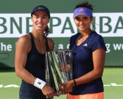 """Martina Hingis and Sania Mirza defeat Ekaterina Makarova and Elena Vesnina to win the Womenís Doubles Championship on Stadium 1 at the 2015 BNP Paribas Open in Indian Wells, California on Saturday, March 21, 2015."""