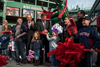 """Boston Mayor Marty Walsh, Boston Red Sox President & CEO Larry Lucchino, Chairman Tom Werner, and local kids participate in a ribbon cutting ceremony for the opening of a newly constructed Gate K Kids Concourse during a walk through of Fenway Park in Boston, Massachusetts Monday, April 6, 2015."""