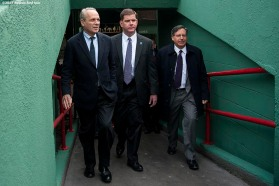 """Boston Red Sox President & CEO Larry Lucchino, Boston Mayor Marty Walsh, and Chairman Tom Werner walk up a concourse into the stadium during a walk through of Fenway Park in Boston, Massachusetts Monday, April 6, 2015."""