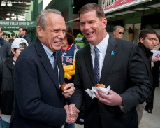 """Boston Red Sox President & CEO Larry Lucchino and Boston Mayor Marty Walsh share a laugh during a walk through of Fenway Park in Boston, Massachusetts Monday, April 6, 2015."""