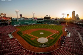 """The sun rises over Fenway Park in Boston, Massachusetts on home Opening Day of the 2015 season Monday, April 13, 2015."""