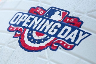 """""""A base with an Opening Day logo is shown before the Boston Red Sox 2015 home opener against the Washington Nationals Monday, April 13, 2015 at Fenway Park in Boston, Massachusetts."""""""