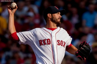 """Boston Red Sox pitcher Rick Porcello delivers during the sixth inning of a home opening game against the Washington Nationals Monday, April 13, 2015 at Fenway Park in Boston, Massachusetts."""