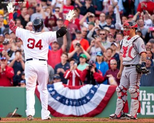 """""""Boston Red Sox designated hitter David Ortiz reacts after hitting a solo home run during the sixth inning of a home opening game against the Washington Nationals Monday, April 13, 2015 at Fenway Park in Boston, Massachusetts."""""""