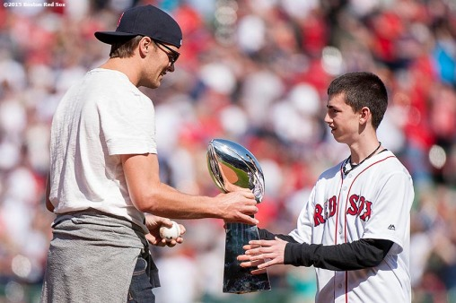 """New England Patriots quarterback Tom Brady greets Marathon victim family member Henry Richard before throwing out the ceremonial first pitch during a pre-game ceremony before the Boston Red Sox 2015 home opener against the Washington Nationals Monday, April 13, 2015 at Fenway Park in Boston, Massachusetts."""