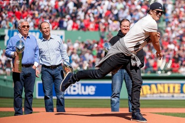 """New England Patriots quarterback Tom Brady throws out the ceremonial first pitch during a pre-game ceremony before the Boston Red Sox 2015 home opener against the Washington Nationals Monday, April 13, 2015 at Fenway Park in Boston, Massachusetts."""