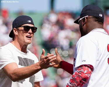 """""""New England Patriots quarterback Tom Brady reacts with Boston Red Sox designated hitter David Ortiz after throwing out the ceremonial first pitch during a pre-game ceremony before the Boston Red Sox 2015 home opener against the Washington Nationals Monday, April 13, 2015 at Fenway Park in Boston, Massachusetts."""""""