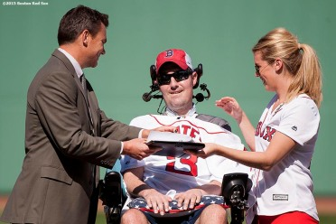 """ALS survivor Pete Frates is presented with an official team contract by General Manager Ben Cherington during a pre-game ceremony before the Boston Red Sox 2015 home opener against the Washington Nationals Monday, April 13, 2015 at Fenway Park in Boston, Massachusetts."""