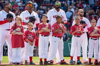"""Boston Red Sox players Pablo Sandoval, Hanley Ramirez, David Ortiz, and Dustin Pedroia line up with kids during a pre-game ceremony before the Boston Red Sox 2015 home opener against the Washington Nationals Monday, April 13, 2015 at Fenway Park in Boston, Massachusetts."""