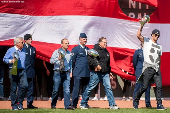 """""""New England Patriots quarterback Tom Brady, head coach Bill Belichick, President Jonathan Kraft and owner Robert Kraft are introduced with the Super Bowl trophies during a pre-game ceremony before the Boston Red Sox 2015 home opener against the Washington Nationals Monday, April 13, 2015 at Fenway Park in Boston, Massachusetts."""""""
