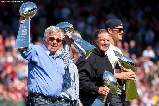 """New England Patriots quarterback Tom Brady, head coach Bill Belichick, owner Robert Kraft are introduced with the Super Bowl trophies during a pre-game ceremony before the Boston Red Sox 2015 home opener against the Washington Nationals Monday, April 13, 2015 at Fenway Park in Boston, Massachusetts."""