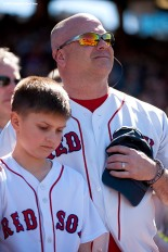 """Fans look on during a moment of silence at 2:49 PM recognizing the anniversary of the Boston Marathon bombings during a game between the Boston Red Sox and the Washington Nationals at Fenway Park in Boston, Massachusetts Wednesday, April 15, 2015."""