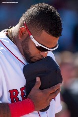 """Boston Red Sox third baseman Pablo Sandoval pauses for a moment of silence at 2:49 PM recognizing the anniversary of the Boston Marathon bombings during a game between the Boston Red Sox and the Washington Nationals at Fenway Park in Boston, Massachusetts Wednesday, April 15, 2015."""