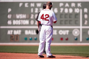 """Boston Red Sox second baseman Dustin Pedroia pauses for a moment of silence at 2:49 PM recognizing the anniversary of the Boston Marathon bombings during a game between the Boston Red Sox and the Washington Nationals at Fenway Park in Boston, Massachusetts Wednesday, April 15, 2015."""