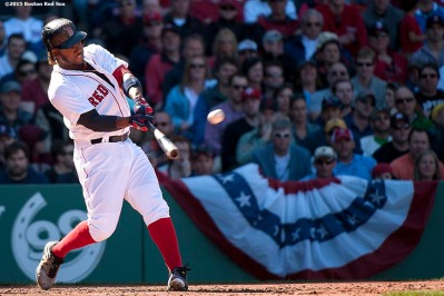 """Boston Red Sox left fielder Hanley Ramirez hits a two run home run during the fifth inning of a game against the Washington Nationals at Fenway Park in Boston, Massachusetts Wednesday, April 15, 2015."""