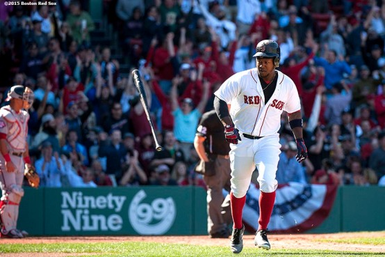 """Boston Red Sox left fielder Hanley Ramirez flips his bat after hitting a two run home run during the fifth inning of a game against the Washington Nationals at Fenway Park in Boston, Massachusetts Wednesday, April 15, 2015."""