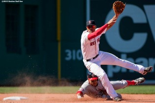"""Boston Red Sox shortstop Xander Bogaerts turns a double play during the sixth inning of a game against the Washington Nationals at Fenway Park in Boston, Massachusetts Wednesday, April 15, 2015."""
