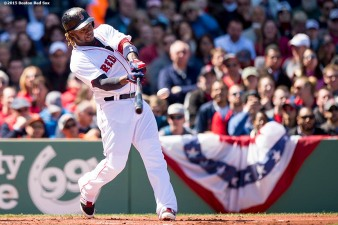 """Boston Red Sox left fielder Hanley Ramirez hits a three-run home run during the first inning of a game against the Baltimore Orioles at Fenway Park in Boston, Massachusetts Sunday, April 19, 2015."""