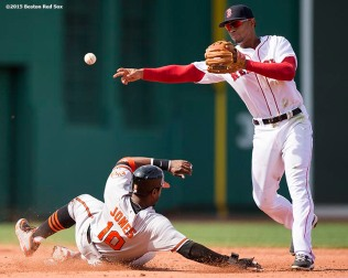 """Boston Red Sox shortstop Xander Bogaerts turns a double play over center fielder Adam Jones during the fifth inning of a game against the Baltimore Orioles at Fenway Park in Boston, Massachusetts Sunday, April 19, 2015."""
