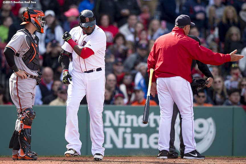 """Boston Red Sox designated hitter David Ortiz throws his bat after being ejected from the game during the fifth inning of a game against the Baltimore Orioles at Fenway Park in Boston, Massachusetts Sunday, April 19, 2015."""