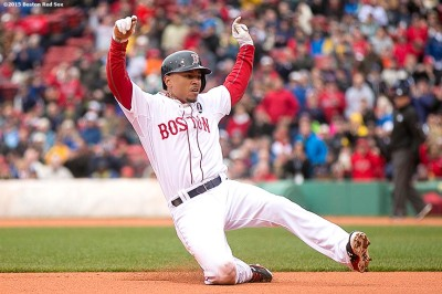 """Boston Red Sox center fielder Mookie Betts slides as he steals third base during the first inning of a game against the Baltimore Orioles at Fenway Park in Boston, Massachusetts Monday, April 20, 2015."""