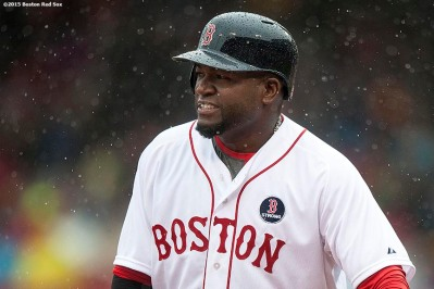 """Boston Red Sox designated hitter David Ortiz looks on in the rain during the seventh inning of a game against the Baltimore Orioles at Fenway Park in Boston, Massachusetts Monday, April 20, 2015."""