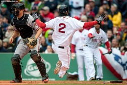 """Boston Red Sox shortstop Xander Bogaerts slides as he scores during the third inning of a game against the Baltimore Orioles at Fenway Park in Boston, Massachusetts Monday, April 20, 2015."""
