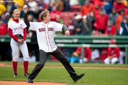"""Four Time Boston Marathon winner Bill Rodgers throws out the ceremonial first pitch before a game between the Boston Red Sox and the Baltimore Orioles at Fenway Park in Boston, Massachusetts Monday, April 20, 2015."""