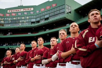 """Boston College teammates line up during the National Anthem before the Championship game between Boston College and University of Massachusetts as part of the Baseball Beanpot at Fenway Park in Boston, Massachusetts Wednesday, April 22, 2015."""