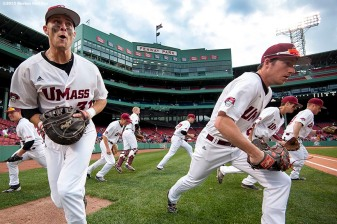 """University of Massachusetts take the field before the Championship game between Boston College and University of Massachusetts as part of the Baseball Beanpot at Fenway Park in Boston, Massachusetts Wednesday, April 22, 2015."""