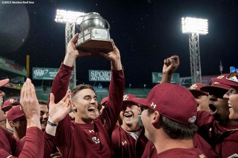 """Members of the Boston College baseball team celebrate after defeating University of Massachusetts to win the Baseball Beanpot Championship game at Fenway Park in Boston, Massachusetts Wednesday, April 22, 2015."""