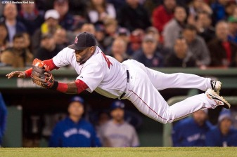 """Boston Red Sox third baseman Pablo Sandoval dives to catch a bunt during the fourth inning of a game against the Toronto Blue Jays at Fenway Park in Massachusetts Monday, April 27, 2015."""