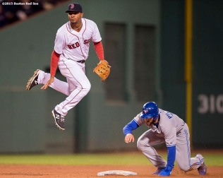 """Boston Red Sox shortstop Xander Bogaerts turns a double play during the fourth inning of a game against the Toronto Blue Jays at Fenway Park in Massachusetts Monday, April 27, 2015."""