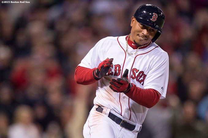 """""""Boston Red Sox center fielder Mookie Betts reacts after hitting a game winning walk-off single during the ninth inning of a game against the Toronto Blue Jays at Fenway Park in Massachusetts Monday, April 27, 2015."""""""