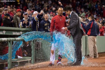 """Boston Red Sox center fielder Mookie Betts is given a Gatorade shower after hitting a game winning walk-off single during the ninth inning of a game against the Toronto Blue Jays at Fenway Park in Massachusetts Monday, April 27, 2015."""