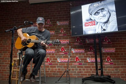 """Singer James Taylor plays guitar during a press conference announcing his new song 'Angels Of Fenway' at Fenway Park in Boston, Massachusetts Sunday, May 3, 2015."""