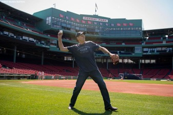 """Singer James Taylor warms up in preparation to throw out the ceremonial first pitch before a game at Fenway Park in Boston, Massachusetts Sunday, May 3, 2015."""
