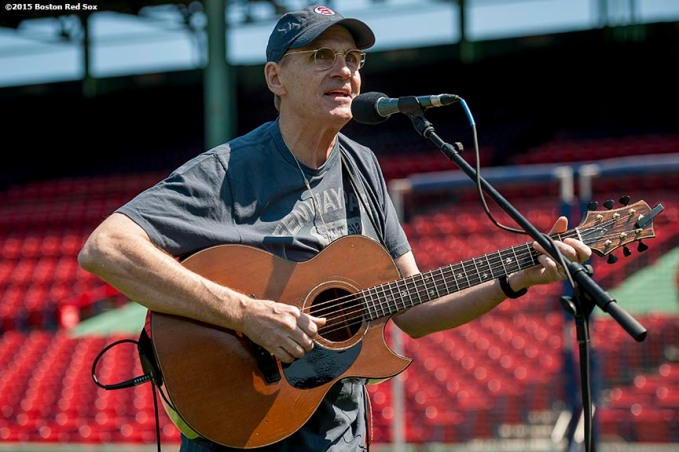 """Singer James Taylor plays during a sound check before a game at Fenway Park in Boston, Massachusetts Sunday, May 3, 2015."""