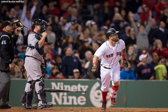 """Boston Red Sox first baseman Mike Napoli hits a three run home run during the sixth inning of a game against the New York Yankees at Fenway Park in Boston, Massachusetts Sunday, May 3, 2015."""