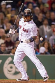 """Boston Red Sox left fielder Hanley Ramirez is hit with a pitch during the sixth inning of a game against the New York Yankees at Fenway Park in Boston, Massachusetts Sunday, May 3, 2015."""