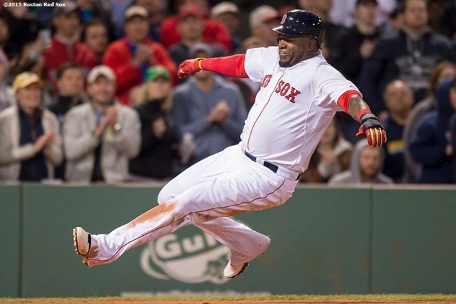 """Boston Red Sox designated hitter David Ortiz slides into home as he scores during the sixth inning of a game against the New York Yankees at Fenway Park in Boston, Massachusetts Sunday, May 3, 2015."""