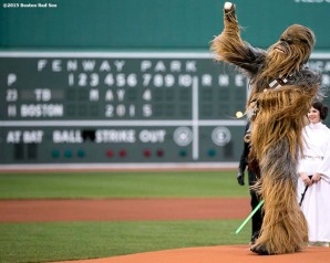 """Chewbacca throws out the ceremonial first pitch during Star Wars Night at Fenway Park in Boston, Massachusetts Monday, May 4, 2015."""