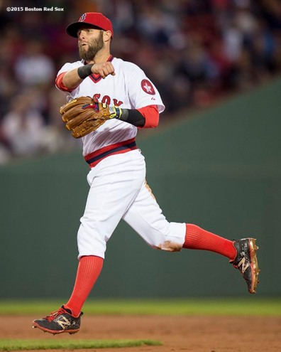 """""""Boston Red Sox second baseman Dustin Pedroia throws to first base during the first inning of a game against the Tampa Bay Rays at Fenway Park in Boston, Massachusetts Tuesday, May 5, 2015."""""""