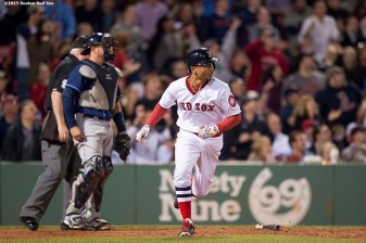 """Boston Red Sox centerfielder Mookie Betts hits a solo home run during the eighth inning of a game against the Tampa Bay Rays at Fenway Park in Boston, Massachusetts Tuesday, May 5, 2015. It was his second home run of the game."""