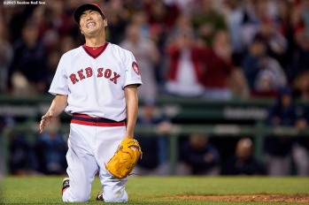 """Boston Red Sox pitcher Koji Uehara reacts after recording the final out to defeat theTampa Bay Rays at Fenway Park in Boston, Massachusetts Tuesday, May 5, 2015."""