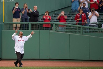 """Former Boston Red Sox pitcher Luis Tiant is introduced during a 1975 40 year reunion pre-game ceremony before a game between the Boston Red Sox and the Tampa Bay Rays at Fenway Park in Boston, Massachusetts Tuesday, May 5, 2015."""