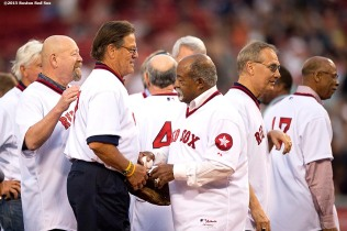 """Former Boston Red Sox catcher Carlton Fisk and pitcher Luis Tiant shake hands during a 1975 40 year reunion pre-game ceremony before a game between the Boston Red Sox and the Tampa Bay Rays at Fenway Park in Boston, Massachusetts Tuesday, May 5, 2015."""