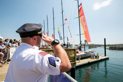 NEWPORT, RI - MAY 17: In this handout image provided by the Volvo Ocean Race, an officer salutes as the National Anthem is sung during the start of Leg 7 from Newport to Lisbon on May 17, 2015 in Newport, Rhode Island. The Volvo Ocean Race 2014-15 is the 12th running of this ocean marathon. Starting from Alicante in Spain on October 11, 2014, the route, spanning some 39,379 nautical miles, visits 11 ports in eleven countries (Spain, South Africa, United Arab Emirates, China, New Zealand, Brazil, United States, Portugal, France, The Netherlands and Sweden) over nine months. The Volvo Ocean Race is the world's premier ocean yacht race for professional racing crews. (Photo by Billie Weiss / Volvo Ocean Race via Getty Images)